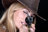 Beautiful cowgirl shooting — Stock Photo