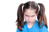 Cute angry girl with funny grimace — Stock Photo