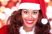 Beautiful brunette wearing santa claus — Foto Stock
