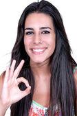 Woman smiling doing the okay sign  — Stock Photo