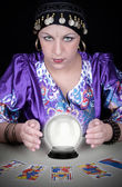 Gypsy fortuneteller uses a crystal ball  — Stock Photo