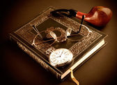 Pocket watch, glasses and book — Stock Photo