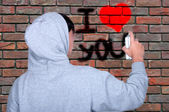 Graffiti young people on using spray paint  — Stock Photo