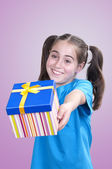 Little girl offering a gift — Stockfoto