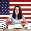 Young girl student pc on the background with American flag — Stock Photo