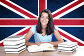 Young girl student pc on the background with UK flag — 图库照片