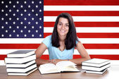 Young girl student pc on the background with American flag — 图库照片