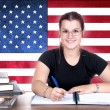 Young girl student pc on the background with american flag — Stock Photo #46456531