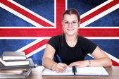 Young girl student pc on the background with british national fl — Stock Photo