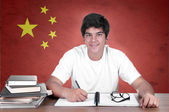 Young boy student on the background with Chinese flag — Stock Photo