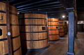 Cellar with oak barrels — Stock Photo