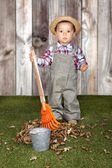 Little baby boy gardener  — Stock Photo