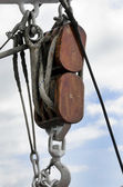 Ancient wooden sailboat pulley and ropes  — Stock Photo