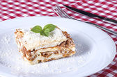 Lasagna served on a white plate  — Stock Photo