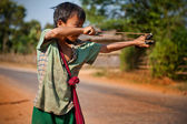 Young boy from Myanmar uses sling — ストック写真