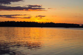 Lonely boat on the lake in sunset time — Foto de Stock
