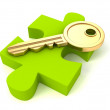 Key on green jigsaw puzzle — Stock Photo