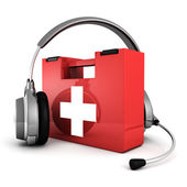 Headphones with madical first aid kit — Stock Photo