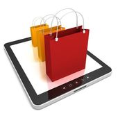 Tablet PC with colorful sale bags — Foto Stock