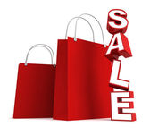 Red shopping bags and sale text — Stock Photo