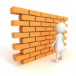 3d man with brick wall — Stock Photo #50260553