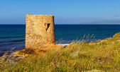 Little tower on the coast — Stock Photo