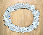Blank oval frame made of shredded pieces of newspaper on a wooden surface. — Stock Photo
