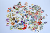 Backdrop of old postage stamps — Photo