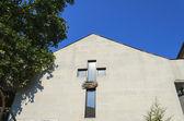 Cross of church on wall — Stock Photo
