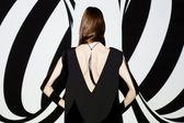 Fashion girl posing back to camera — Stock Photo