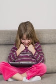 Little girl playing with a digital tablet — Foto Stock