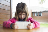 Little girl with a smartphone — Stock Photo