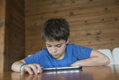 Young boy and a tablet digital — Stock Photo