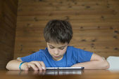 Young boy and a tablet digital — Stockfoto