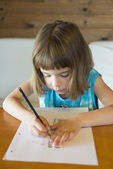 Little girl drawing a straight — Stock Photo