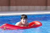 Young boy in a swimming pool — Stock Photo