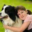 Vintage dressed little girl with Border collie dog — Stock Photo