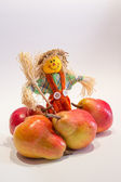 Scarecrow and pears — Stock Photo