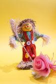 Scarecrow and flower — Stockfoto