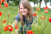 Girl with red poppies — Stok fotoğraf