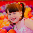 Little girl in a children's play room — Stock Photo #47771473