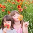 Two small children with flowers — Stock Photo #47849911