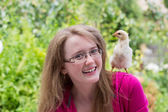 Little girl with chicken — Stock Photo