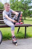 Little boy on roller skates — Stockfoto