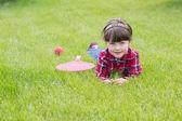 Little girl on the grass — Stock Photo