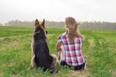 Girl with a German Shepherd — Stock Photo