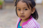 Bolivian girl playing — Stock Photo