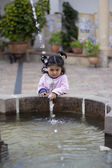 Playing around fountain — Stock Photo