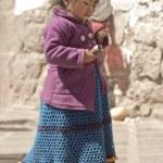 Peruvian girl eating ice-cream — Stock Photo #45949849