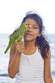 Girl with her parrot pet — Stock Photo